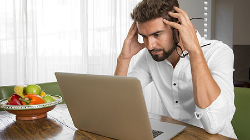 Surprised man reading bad news